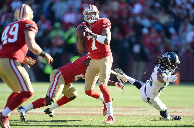 Description of . San Francisco 49ers' quarterback Colin Kaepernick (7) looks for an open receiver in the first quarter of their football gam...