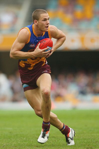 Jack Redden of the Lions runa the ball during the round seven AFL match between the Brisbane Lions and the West Coast Eagles at The Gabba on May 11, 2013 in Brisbane, Australia.