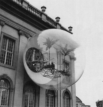 """This contribution was produced to the Documenta 5 in Kassel: a transparent sphere with a diameter of 8 metres was placed in front of the main facade of the Friedericianum. A catwalk made of standard tubular steel sections projected through a window from the interior of the building. A tubular steel ring was fixed to this footbridge, at a slight distance from the façade. This ring formed the external support for a PVC foil shell that formed a sphere when inflated into shape by an air pump."""