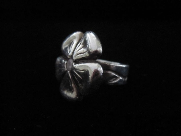 Flower in Bloom.  Made from Precious Metal Clay this ring has a vine wrapping around the shank and a cubic Zirconia in the centre of the flower.