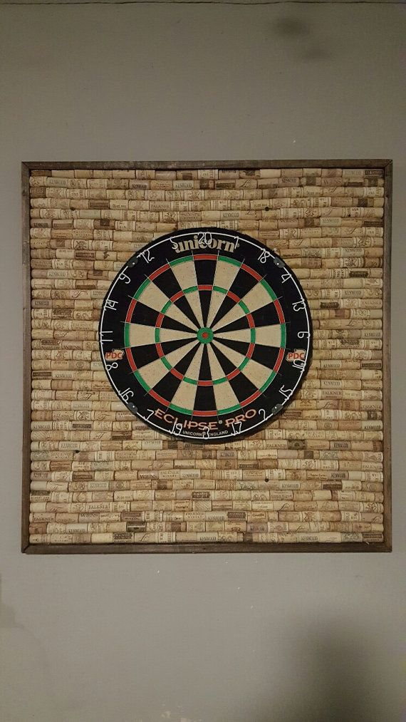 Protect your wall from stray darts with this unique dartboard backer made with over 400 wine corks. Comes with a brand new 18 inch regulation dart board which is securely attached. (Cork backboard can be purchased without dart board for a reduced price.) Board pictured is trimmed in solid wood and finished with walnut stain. Other finishes available. Approximately 35 height; 28 length; 2 wide   Board weights about 30 lbs so its recommended to screw it into wall studs to ensure maximum…