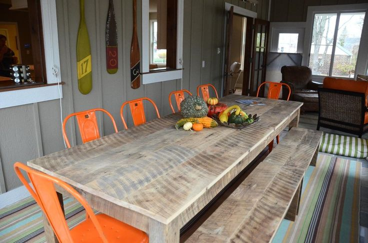 Fantastic, fun new family home in quaint Douglas, Michigan. A transitional open-concept house with an outdoor dining area complete with orange outdoor dining chairs that pair perfectly with the rustic, wooden outdoor table, and fall themed decor | Bayberry Cottage - Michigan's Favourite Source for Interior Design!