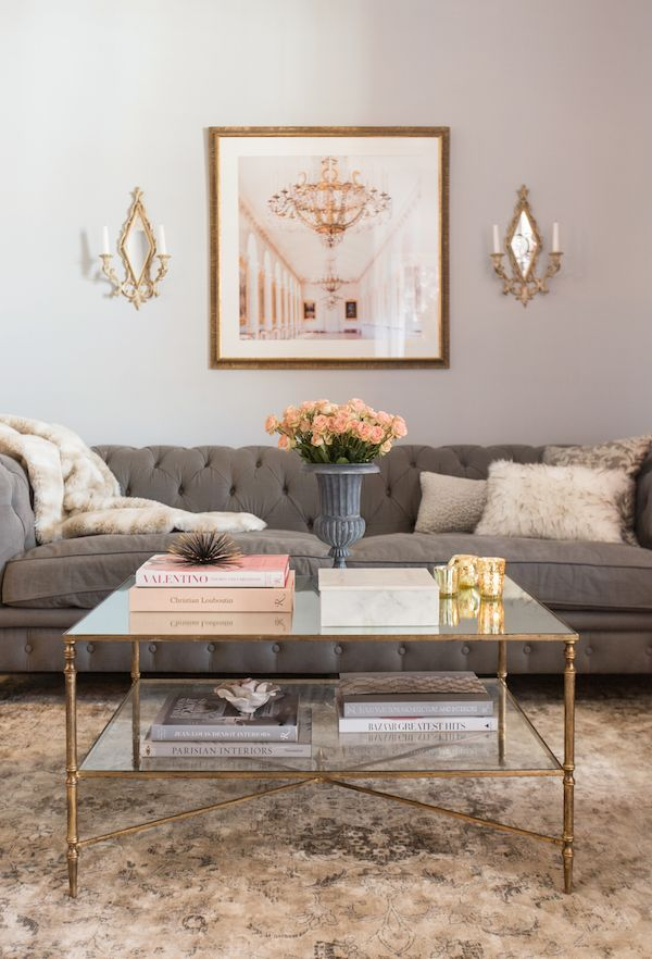 UTTERMOST HENZLER MIRRORED GLASS COFFEE TABLE WITH SHELF  Finished In Gold Leaf With Heavy Antiquing On Iron Frame AndIron Cross Stretchers. Top Is Reinforced Mirror And GalleryShelfIs Clear Tempered Glass.