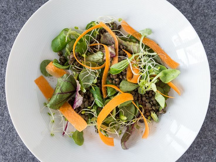 Puy lentils are a delicious and nutritious legume that goes well with practically anything. Serve them hot in casserole dishes or cold in salads.  This salad is a great lunch dish and if you pre cook the lentils it takes just 2 minutes to make it!  This recipe yields 4 servings.  Ingredients 250 g dried Puy lentils Assorted salad leaves