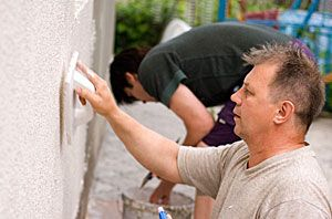 Stucco is easy to work with. Any homeowner willing to learn and take the time can usually repair a crack or even a missing piece of stucco.