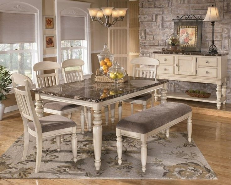 Vintage Dining Room Design Idea With 7 Piece Set In Beige Finish And Gray Floral Area Rug Antique Pendant Lamp Also Exposed Stone Wall Accent