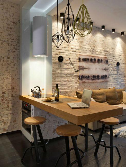 Todo en uno: salón, cocina, comedor, zona de trabajo… Un pequeño apartamento y soluciones prácticas.