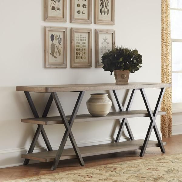 Jopling Console Table   Crafted from oak solids and veneers, the Jopling console table features an open, three-tiered design with elegant x-shaped supports.