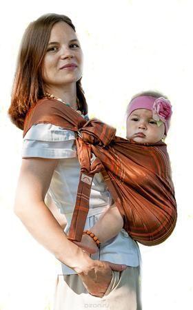 """Мамарада Слинг с кольцами Терракота размер S  — 2447р. --------- Слинг с кольцами позволяет носить ребенка как горизонтально в положении """"Колыбелька"""" так и в вертикальном положении. В слинге в положении """"Колыбелька"""" малыш распологается точно так же, как у мамы на руках, что особенно актуально для новорожденного. Ткань слинга равномерно поддерживает спинку малыша по всей длине. Малышу комфортно и спокойно рядом с мамой. Мама в это время может заняться полезными делами или прогуляться. В…"""