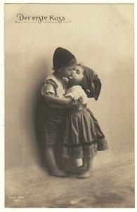 2 vintage children kissing