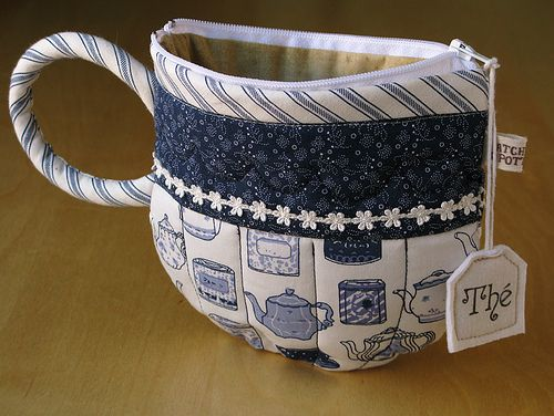 Tea Cup Pouch by PatchworkPottery. The digital PDF pattern includes metric conversion chart, stitches & terms section, illustrated step-by-step instructions and full size templates. Buy for $12.00 CAD at  http://patchworkpottery.bigcartel.com/product/teacup-pouch.