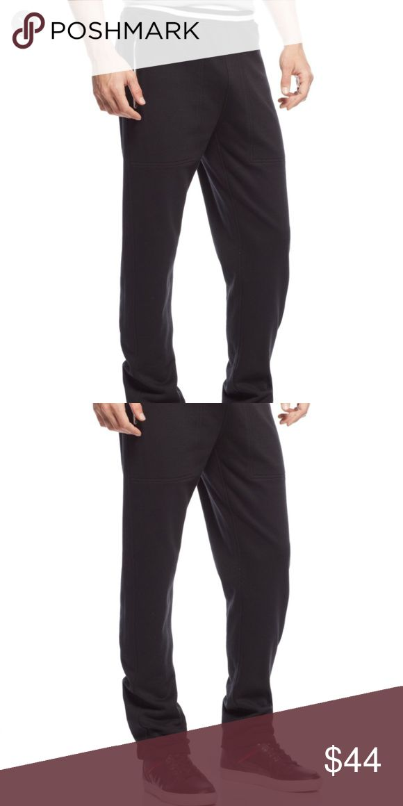 sean john big and tall taped jogger track pants Sean John designed this track pant with a trendy jogger silhouette, striped waistband and secure zip pockets for an off-duty look perfect for the modern man. Sean John men's big and tall pants. Striped elastic waist; interior drawstring closure. Faux fly; pull-on design. Front zip pockets. Tapered leg with elastic hem. Cotton/polyester. Machine washable. Imported. Color: black Sean John Pants Sweatpants & Joggers