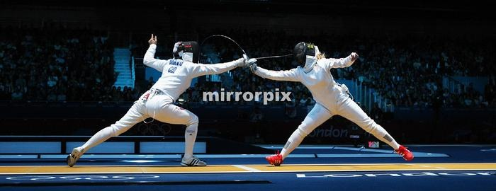 Chile's Caterin Bravo Aranguiz (L) fences against Great Britain's Corinna Lawrence during their Women's Epee fencing bout as part of the London 2012 Olympic games, on July 30, 2012 at the ExCel centre in London.