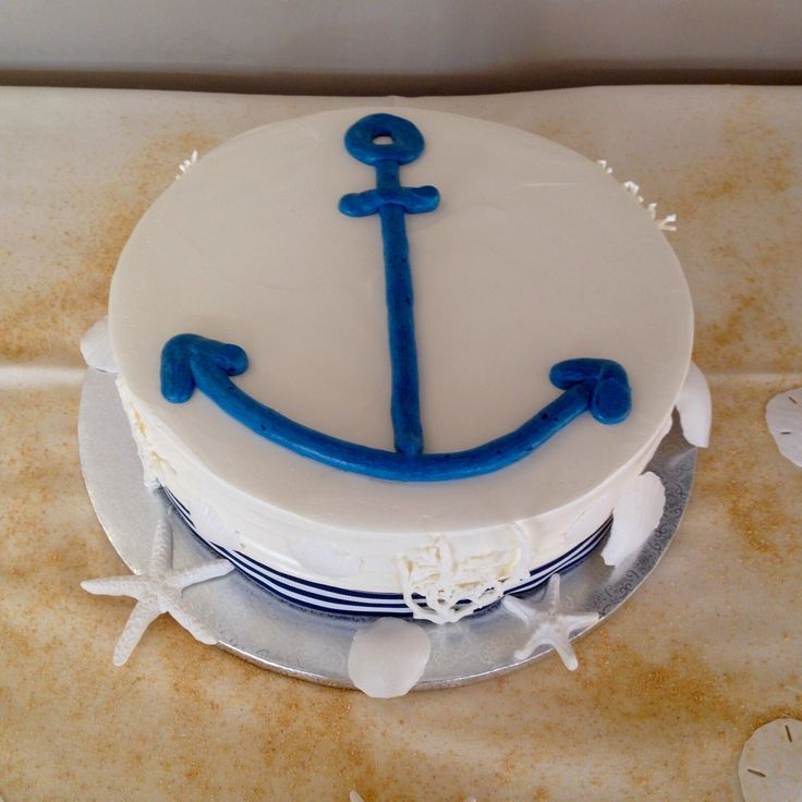 A nautical themed cake for an intimate, small wedding celebration. The anchor is piped from buttercream, the sugarpaste shells and striped ribbon accent the exterior.