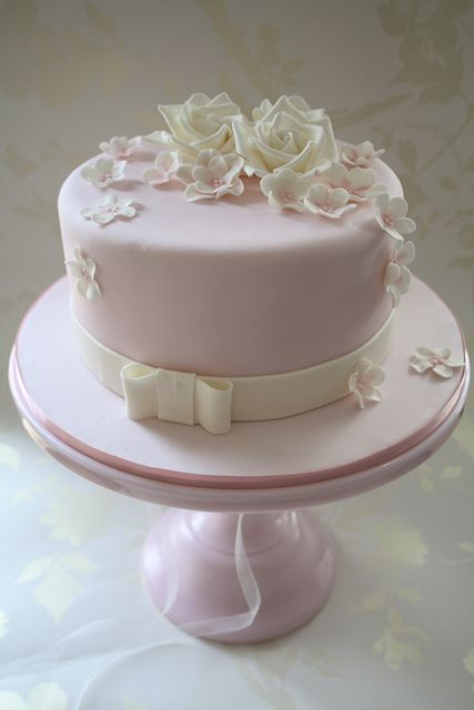 Another sweet palest pink and white flowery simple cake.