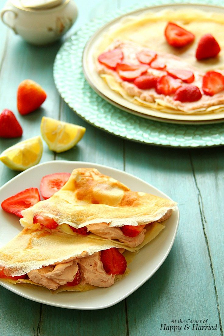 Lemon Crepes With Strawberry Cream Cheese Filling | Delicate lemon crepes filled with strawberry flavored whipped cream cheese and sweet berries is a delightful weekend brunch. @anjanadev