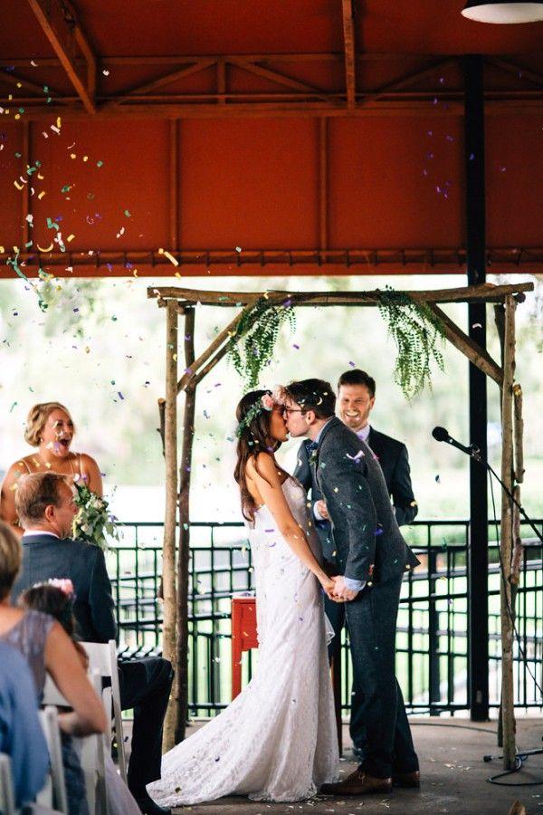 The groomsmen shot off confetti cannons during the couple's first kiss as newlyweds | Photo by Nate + Lori via http://junebugweddings.com/wedding-blog/sentimental-winter-park-farmers-market-wedding/