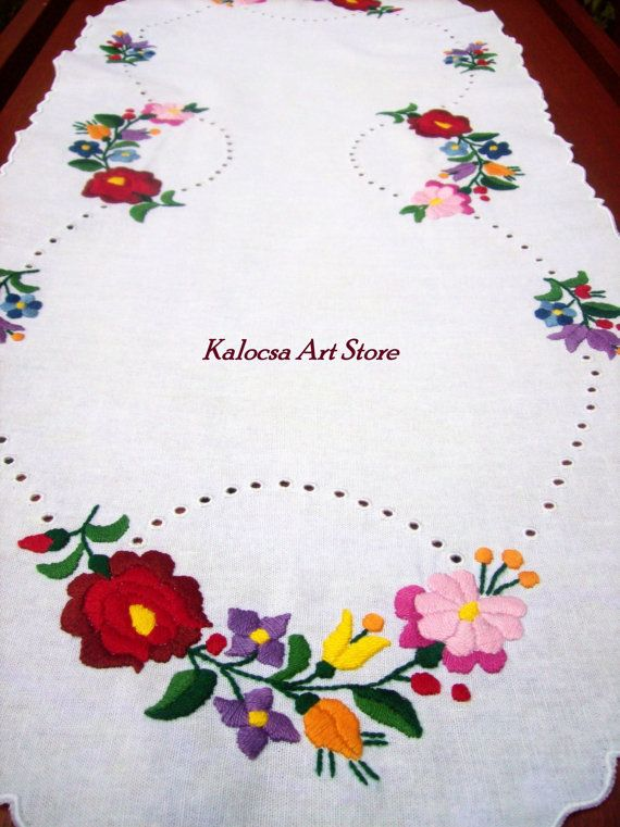 Individually made oval-shaped table runner with hand-embroidered Kalocsai patterns and madeira embroidery. Use this colorful runner to decorate