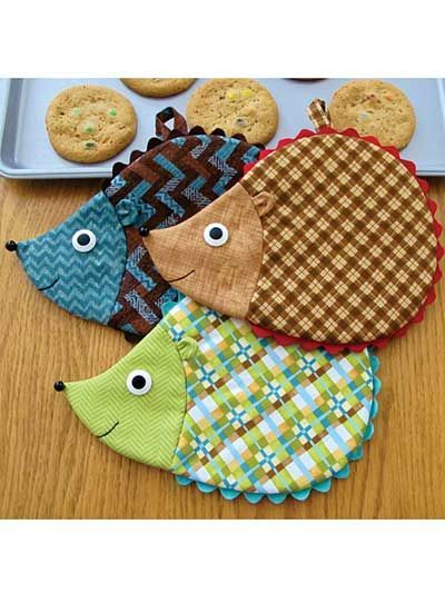 "Adorable hot pads to add some whimsy to your kitchen decor!   These darling hot pads are perfect for giving even the most boring kitchen a little facelift! Sure to bring a smile to anyone's face, these friendly hedgehogs are super easy, quick to stitch and all-around functional. Pattern pieces and full written instructions are included in the pattern. Approximate finished size is 7"" x 9"" each."