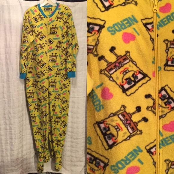 Adult onesie pajamas SpongeBob I ❤️ nerds L Fuzzy adult onesie featuring SpongeBob reads I ❤️ nerds size juniors extra large 15/17 women's large zipper front with footed bottoms only flaw is that some of the little non-slip sticky things on the bottom of the feet are missing great condition very warm. 44 inches around at the chest total length from shoulder to bottom of foot is 69 inches. Made by Nickelodeon. Nickelodeon Intimates & Sleepwear Pajamas