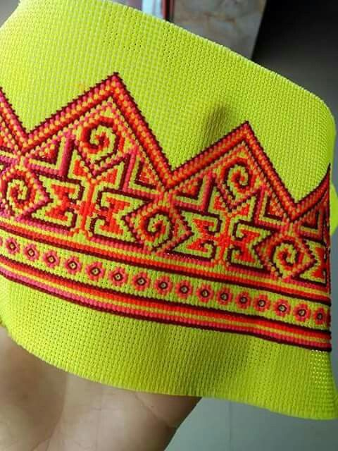 Orange tone in Hmong yellow fabric