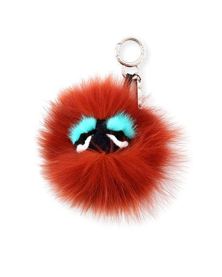 Fendi signature monster charm composed of dyed fox (Finland) fur, dyed mink (Finland) fur, and dyed rex rabbit (China) fur. Easily attaches to your favorite handbag (sold separately). Charm hangs from