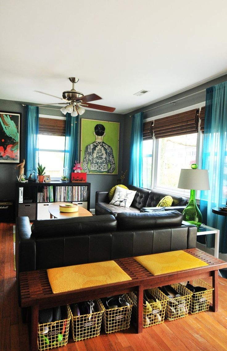 Name: Matt and Mel Location: Fairfax, Virginia Size: 816 square feet Years lived in: 10 mos; Renting Is it ever the case where you visit the home of designers and find that their space isn't the coolest one on the block, filled with creative design and a beautiful harmony of eclectic trinkets? Never! And the graphic home of designer and animator Matt and Mel is thankfully no exception. The couple's warm and bright home greets you at the door with bold color choices and invites you to stay…