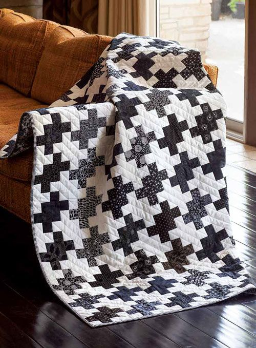 "We love two-color quilts! This one, Adam's Rib, by Tony Jacobson, was fashioned after a robe that Katherine Hepburn wore in the 1949 movie by the same name. She starred opposite Spencer Tracy in classic ""battle of the sexes"" movie, hence the stark black and white color scheme. Pretty cool, right?"