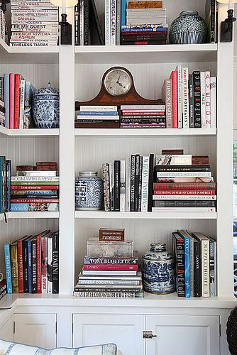 blue and white ginger jars displayed in built-in bookshelves