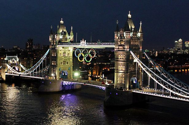 The Olympic rings are lit up on Tower Bridge, London, in preparation for the start of the 2012 London Olympics