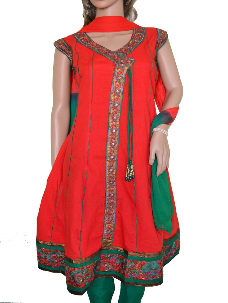 Red and Green Anarkali style Cotton Salwar Kameez with Embroidery lace patch. Additional cloth for optional medium size sleeves available. Match it with simple Gold Jewellery to wear on an Celebratory Occasion. Buy it on www.folklor.in