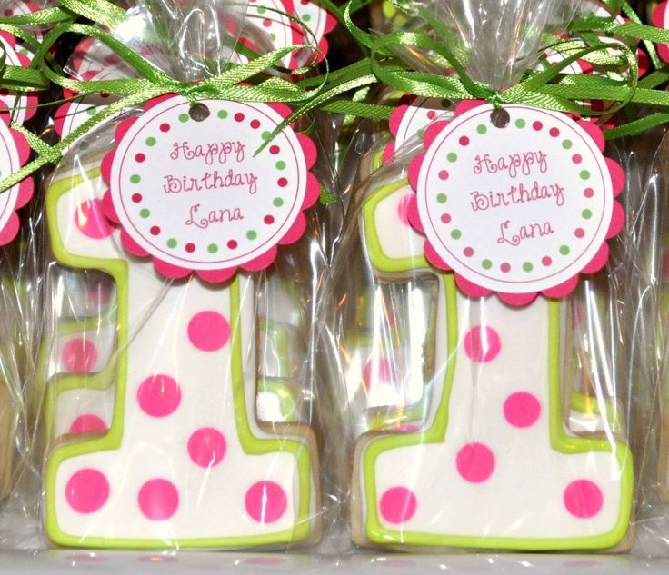 Colorful polka dot cookie idea for a 1st birthday party.  See more first girl birthday party ideas at www.one-stop-party-ideas.com