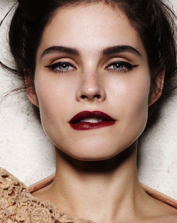 Sultry cat-eye + deep red lips. The perfect holiday makeup. // Photo by David Oldham
