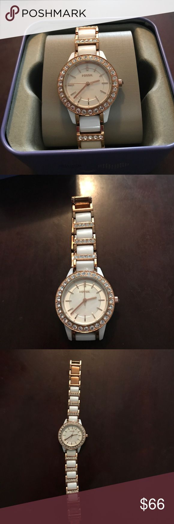 Fossil ceramic and white gold watch Women's Fossil Jesse Ceramic White and Rose tone watch. Preowned, functioning with new Watch battery and in great condition. Fossil watch box included in price. Fossil Jewelry
