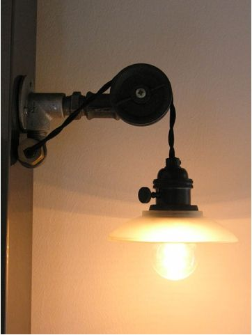 Here's a second industrial wall sconce by Susanne in Germany made from iron piping, pulleys, and socket/shade fitter and black cloth covered twisted wire from Snake Head Vintage lighting supply company