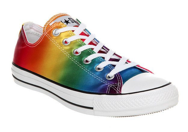 These rainbow Converse would provide a splash of colour peeping out from under a dress. - HA! ... i don't hate these at all lol