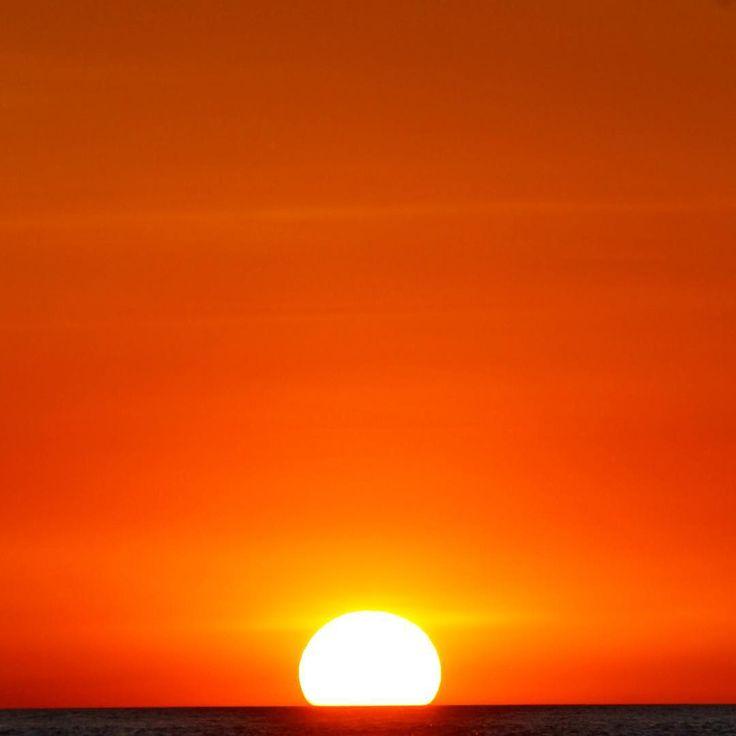 Lightbulb Moment - Happens at the end of the day in #Darwin #NTaustralia. Another stunning #sunset capture by Jonathan Arscott on his #Seadarwin Sunset Fish'n Chips #cruise #SeeAustralia #Sun #orange #whereintheworld