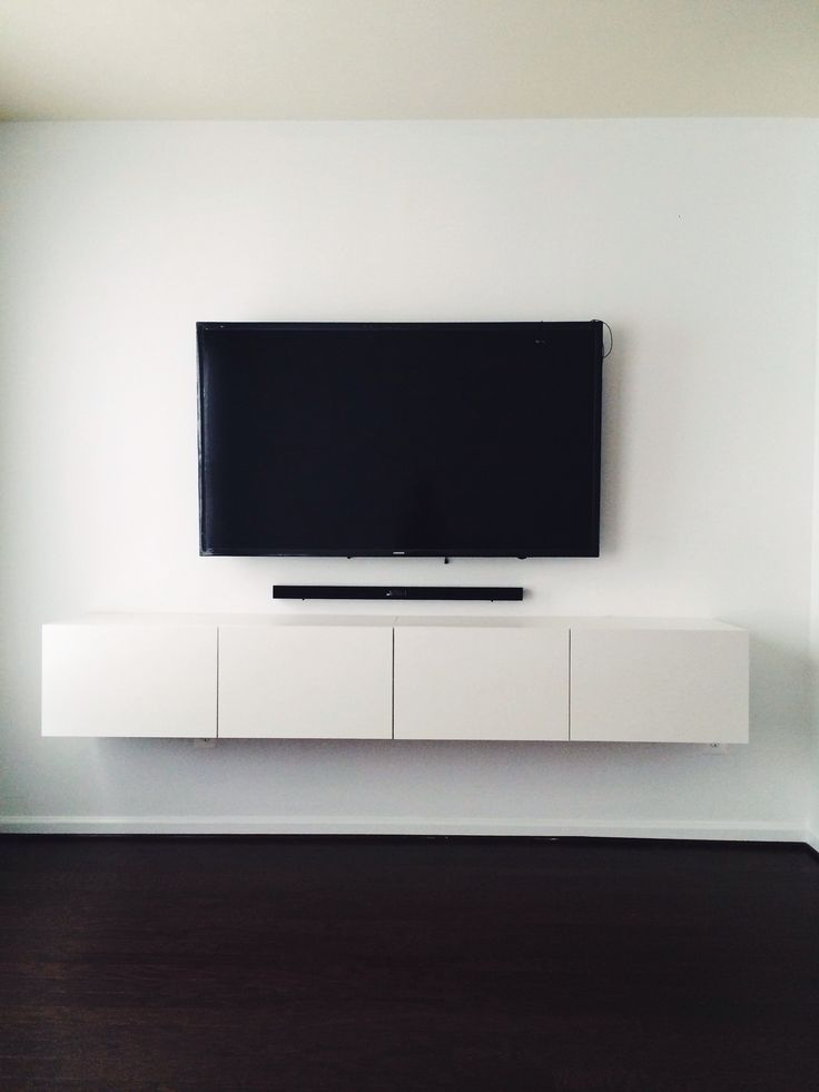 IKEA BESTÅ media console. Mounted tv with hidden wires. Now that's clean.