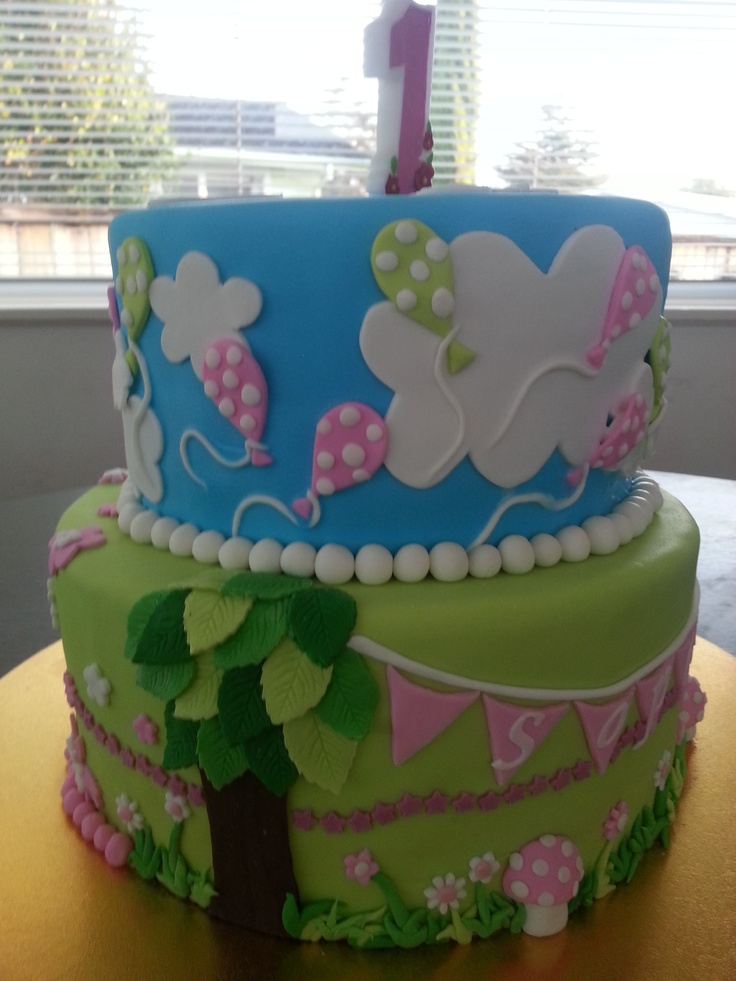 Sophies first birthday. Garden themed cake with spotted balloons and toadstools
