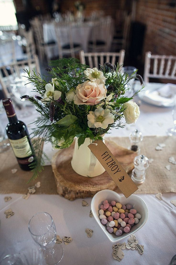 Jug Flowers White Blush Hessian Log Centrepiece Tables Rustic Woodland Spring DIY Wedding http://assassynation.co.uk/