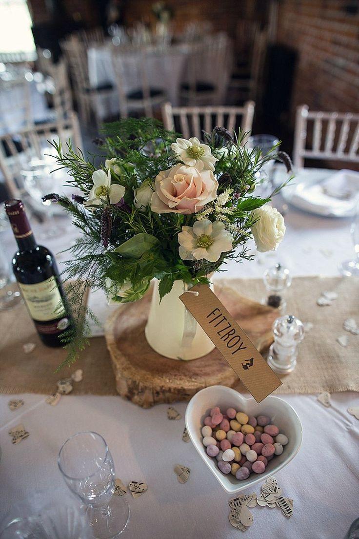 Jug Flowers White Blush Hessian Log Centrepiece Tables Rustic Woodland Spring DIY Wedding http://assassynation.co.uk/