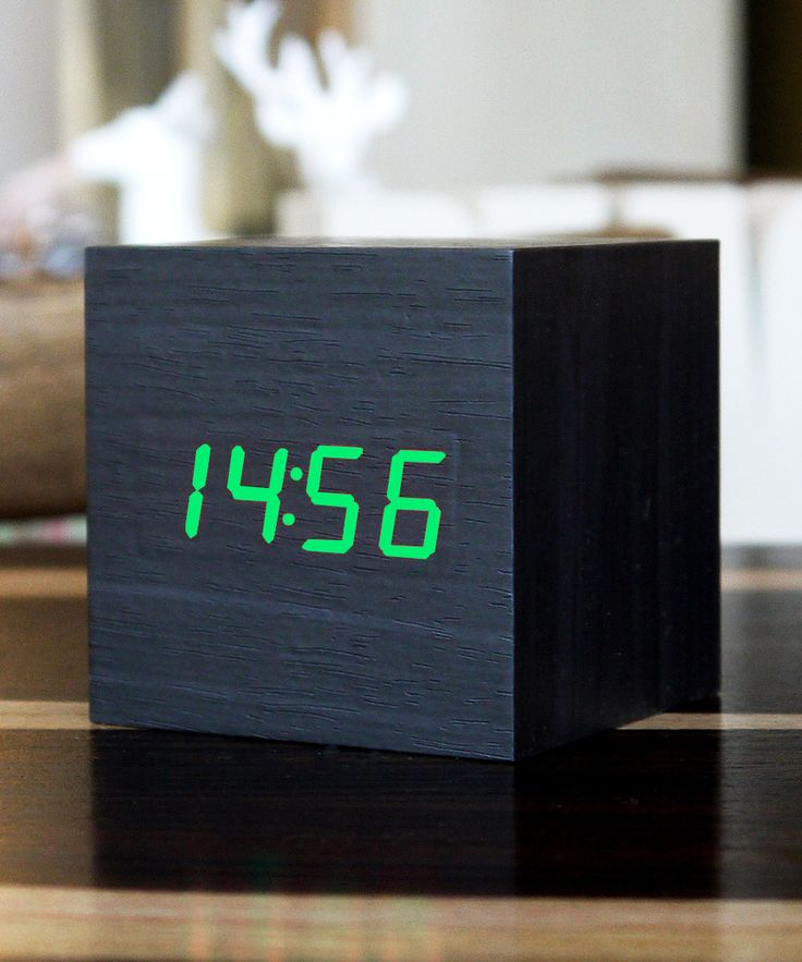 Green LED Black Cube Clock | dotandbo.com.  These wooden style clocks only show the time when you tap the top or snap your fingers. Otherwise they serve as an art piece for a minimalist or natural decor.