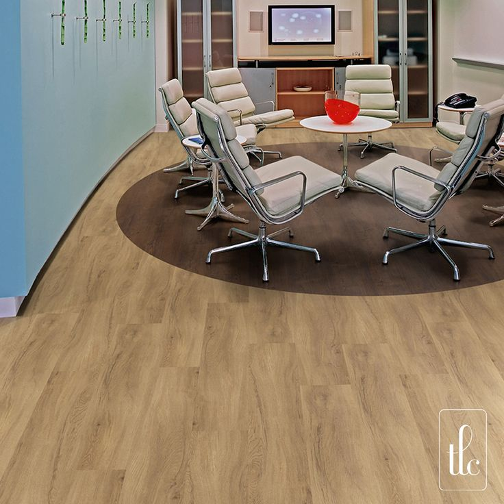 Authentic Oak - 5262 -   A beautiful classic, Authentic Oak suits any interior with its natural charm and character. The distinguished decoration can also be complemented by featuring other wood or stone designs alongside.  (Straight laid with circle design inset using Rosewood, creating a zonal area.)