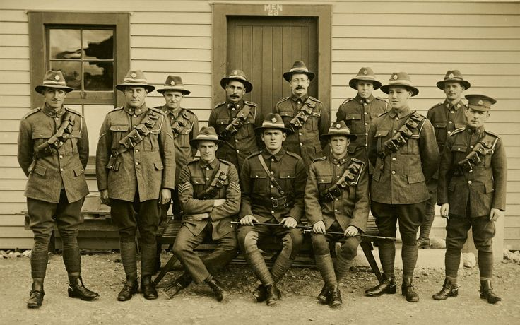 Soldiers in uniform outside barracks; badges unidentified, 1916. [P2-109-278] | Upper Hutt City Library