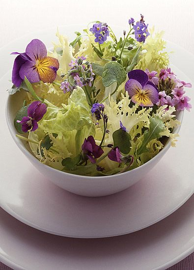 Such a lovely idea - bring the spring-time colour of fresh flowers right onto the dinner table by using dainty edible blossoms in salads like this.