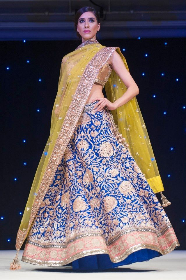Manish Malhotra. Look at border on dupatta. This could be great for the bottom of the lehnga as well as the dupatta border. Looks like silk embroidery with some sequins on the side?