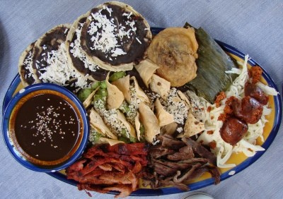 This sampler of Oaxacan cuisine at Sabor de Oaxaca is for two persons but will easily feed three. It includes quesillo, cecina, tasajo, chorizo, pelliscadas, frijoles, guacamole, mole negro, chile relleno, and tamal Oaxaqueo. Recommended. Click on the image for a closer view.