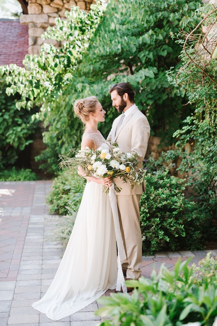 A midsummer garden wedding is just the perfect time to wear a light color or khaki suit! Venue: Willowdale Estate - http://willowdaleestate.com Wedding Dress: Alexandra Grecco - http://www.stylemepretty.com/portfolio/alexandra-grecco-2 Groom's Attire: The Black Tux - http://www.stylemepretty.com/portfolio/the-black-tux   Read More on SMP: http://www.stylemepretty.com/2016/10/10/artistic-styled-wedding-inspiration/