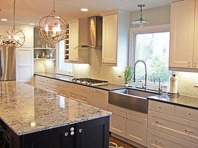 restoration hardware lights / white cabinets / tile backsplash