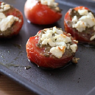roasted tomatoes with pesto and cheese. I do this ALL the time for a ...